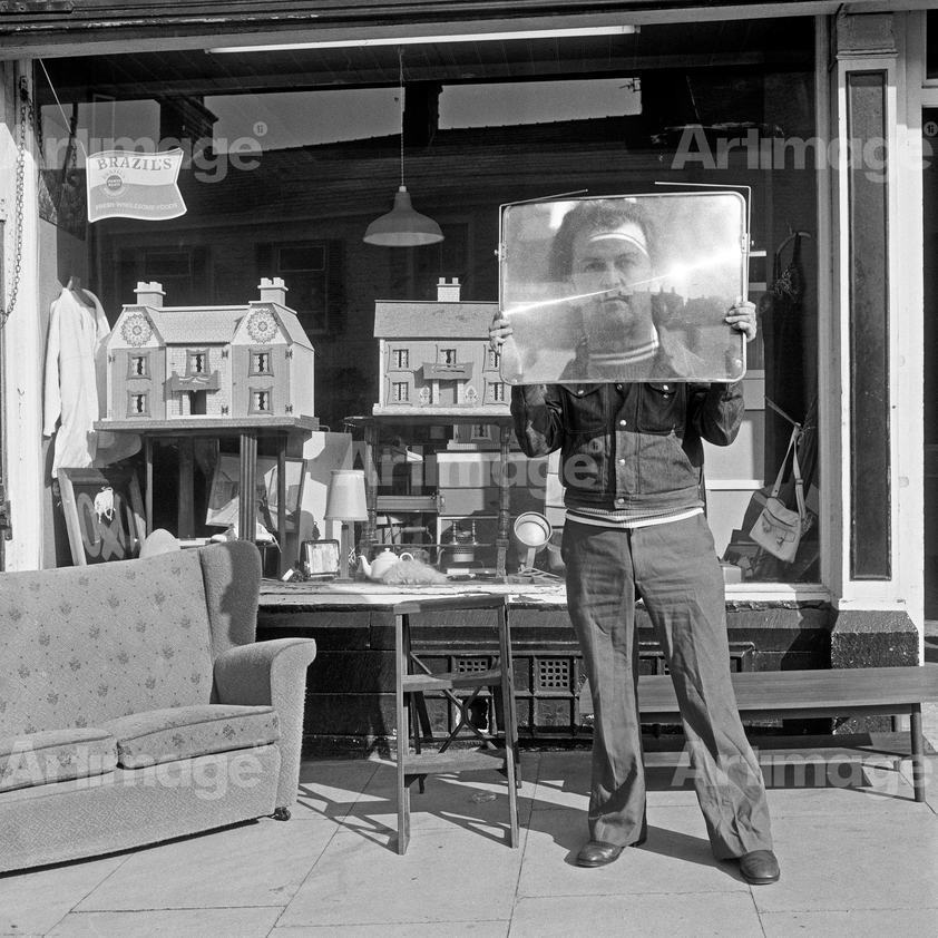 Enlarged version of North of England: Second-hand goods shop with proprietor, Colne, Lancashire, 1975