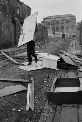 Man reclaiming a door, Byker, 1975