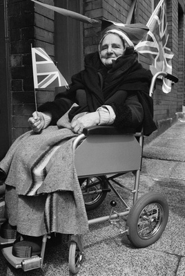 Woman holding a flag at the Queen's Silver Jubilee street pa...