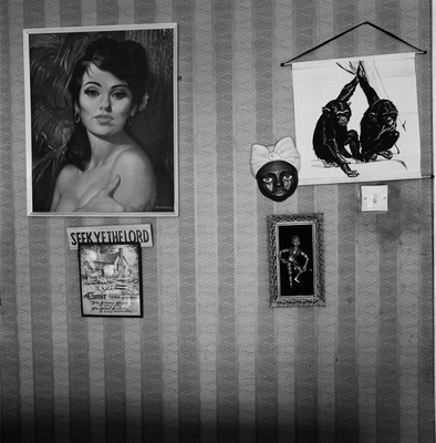Livingroom wall of Mrs Annie Waugh, Byker, 1977