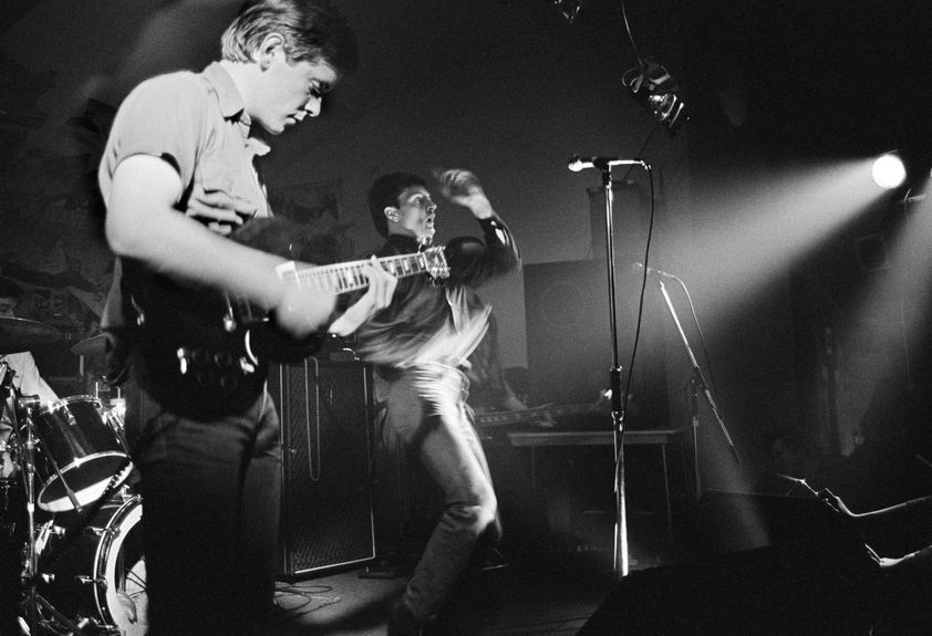 Factory Records: Joy Division on stage at Osbourne Club 'Factory' gig, Miles Platting, Manchester, 1980