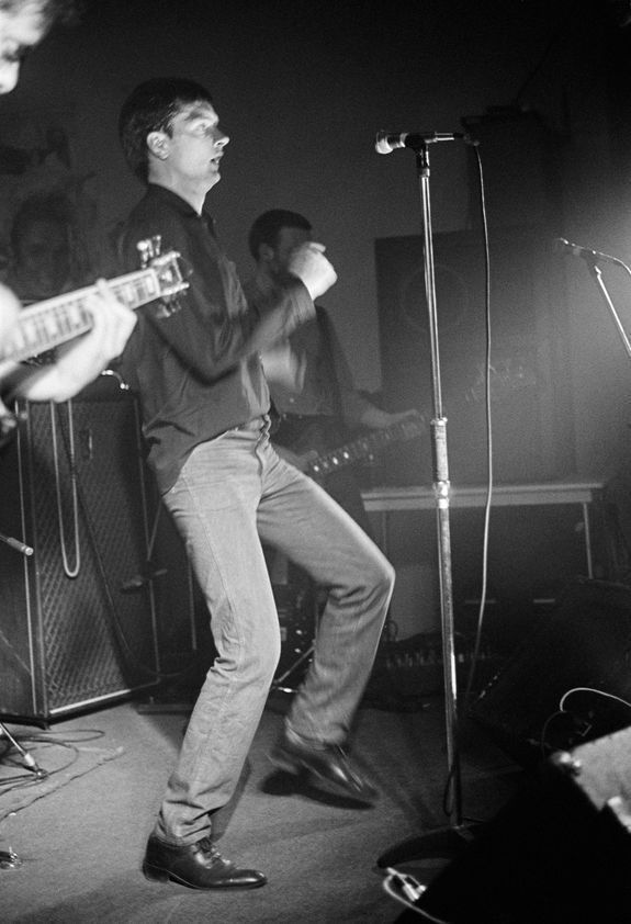 Factory Records: Ian Curtis of Joy Division at Osbourne Club 'Factory' gig, Miles Platting, Manchester, 1980