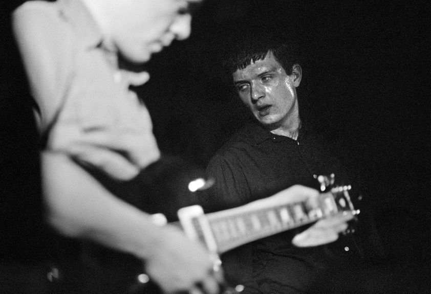 Factory Records: Bernard Sumner and Ian Curtis of Joy Division, on stage, New Osbourne Club 'Factory' gig, Miles Platting, Manchester, 1980