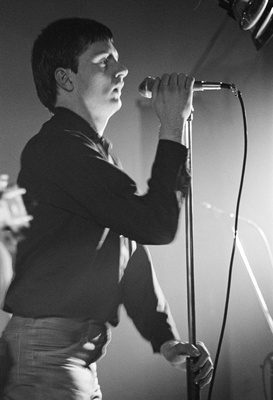 Factory Records: Ian Curtis of Joy Division at Osbourne Club...