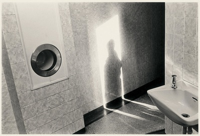 Shadow on Toilet Wall, Asbourne, 1976 By Paul Hill