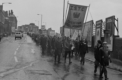 Striking BSC steel workers and supporters marching in protes...